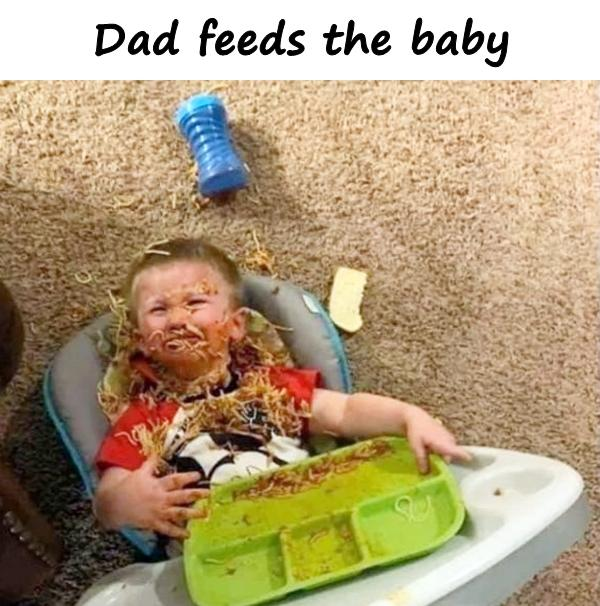 Dad feeds the baby