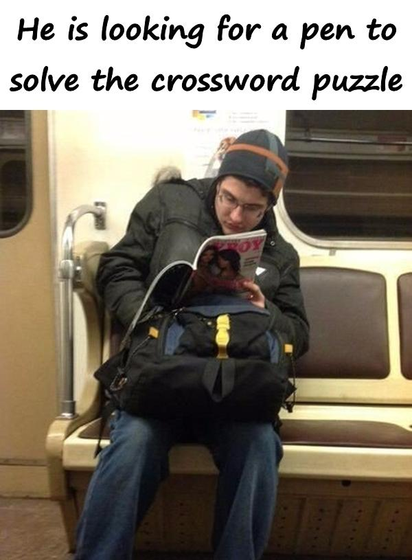 He is looking for a pen to solve the crossword puzzle