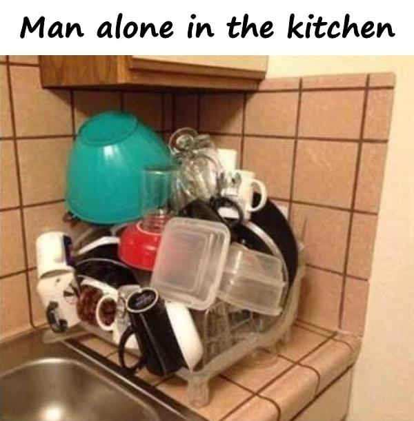Man alone in the kitchen