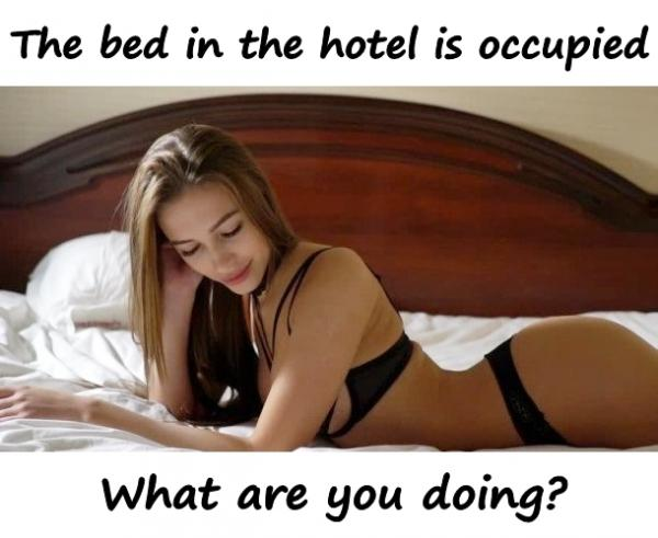 The bed in the hotel is occupied. What are you doing?