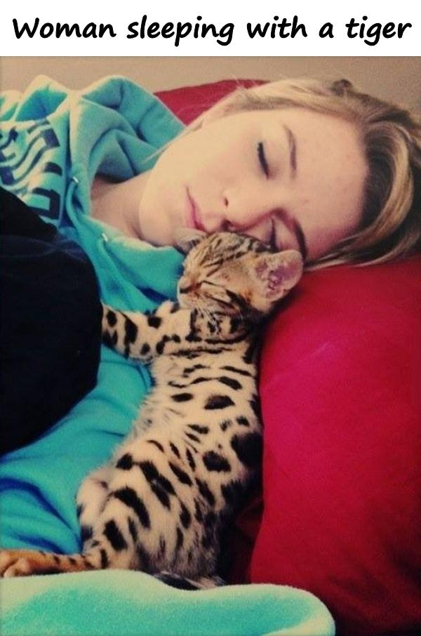 Woman sleeping with a tiger